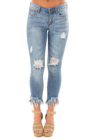 Medium Blue Mid Rise Skinny Jeans with Fray Detail front view