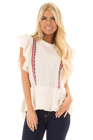 Cream Ruffle Top with Embroidery Detail front close up
