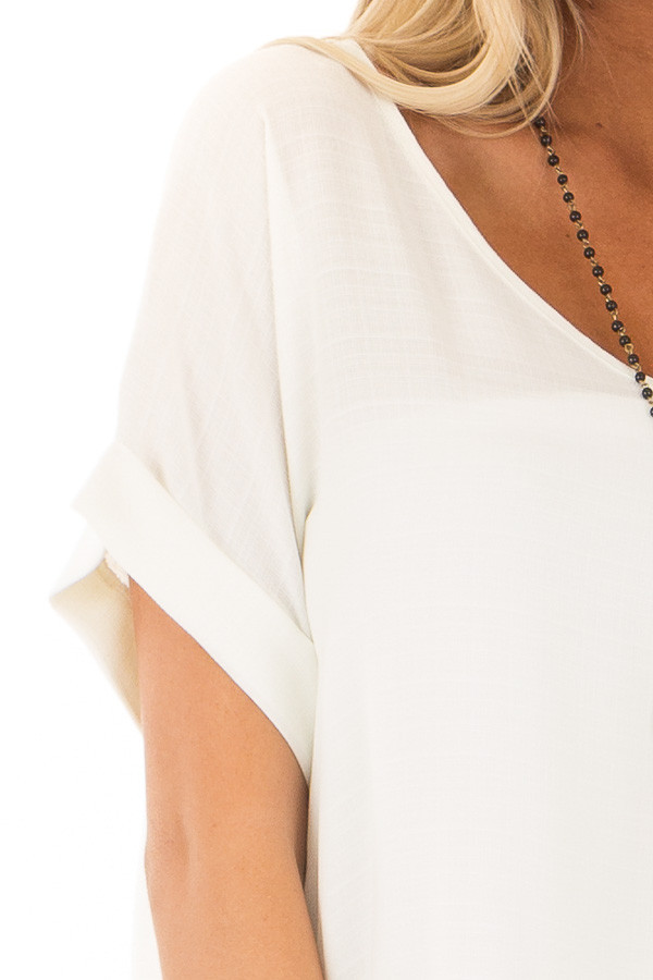 Ivory Cuffed Short Sleeve V Neck Top detail