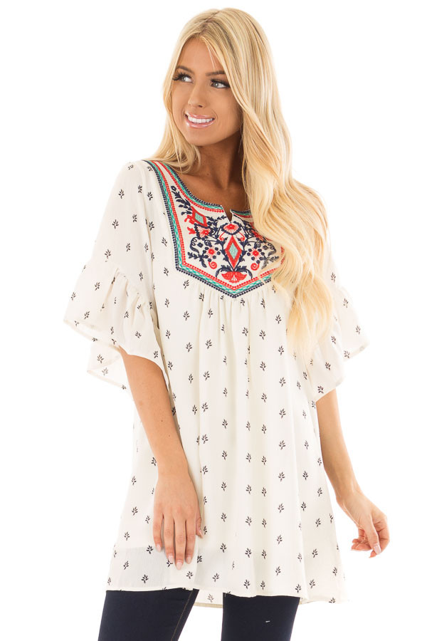 Ivory Patterned Ruffle Sleeve Tunic with Embroidery Detail front close up