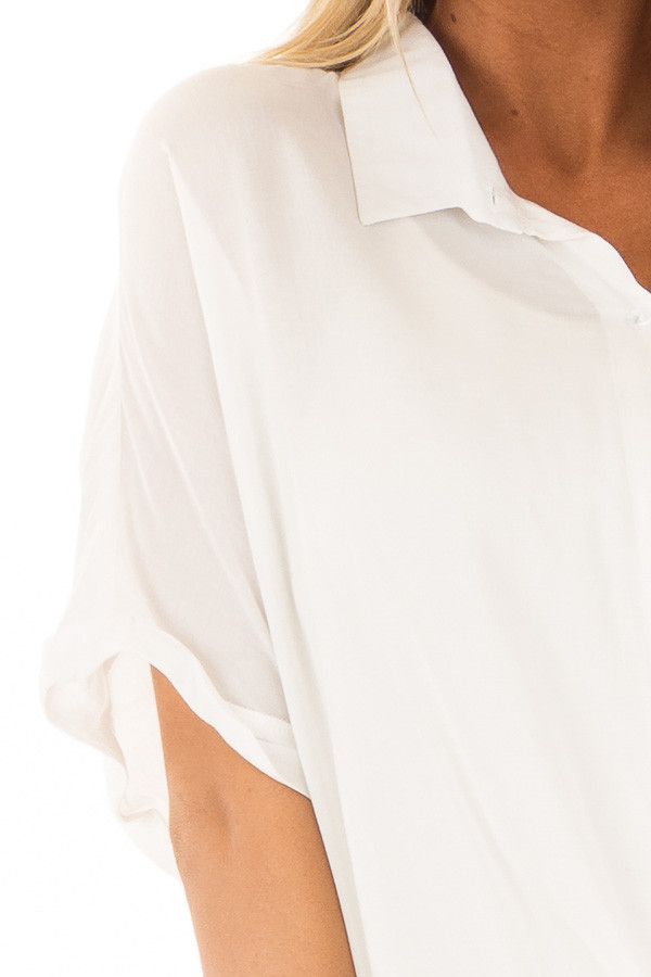 White Button Up Short Sleeve Blouse with Twisted Hem detail