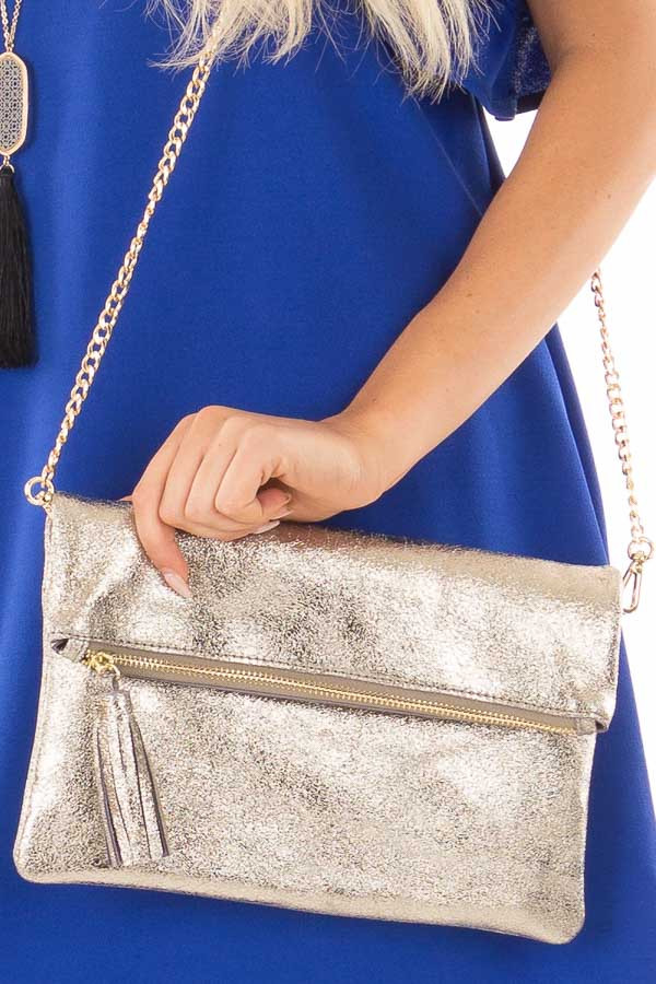 Gold Leather Fold Over Clutch with Tassel close