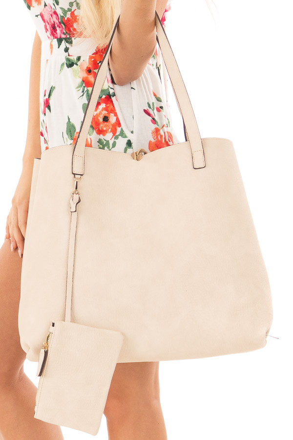 Tan and Ivory Reversible Tote with Tassel Detail side close up
