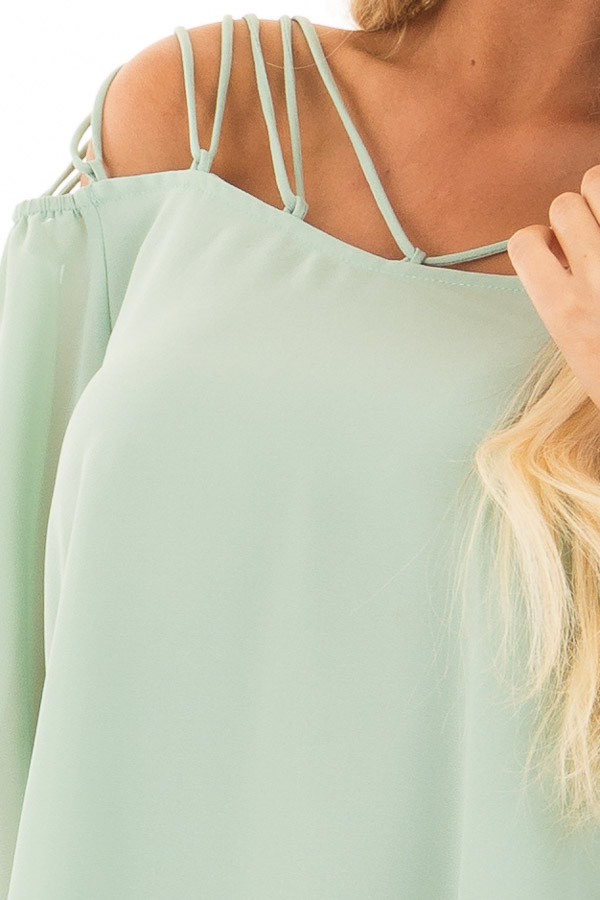 Sage Blouse with Caged Neckline front detail
