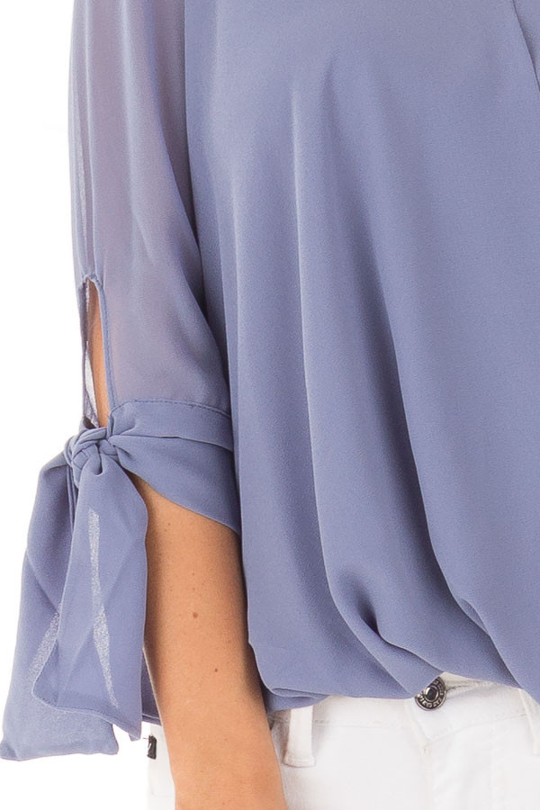 Dusty Blue Surplice Blouse with Tie Sleeve Details front detail