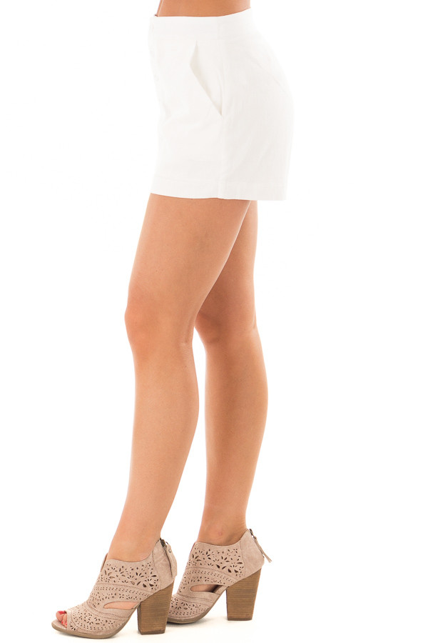 White Buttoned Up Shorts with Side Pockets side view