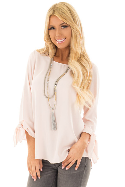 Blush Tied Sleeve Blouse with Rounded Neckline front close up