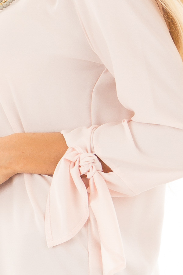 Blush Tied Sleeve Blouse with Rounded Neckline detail
