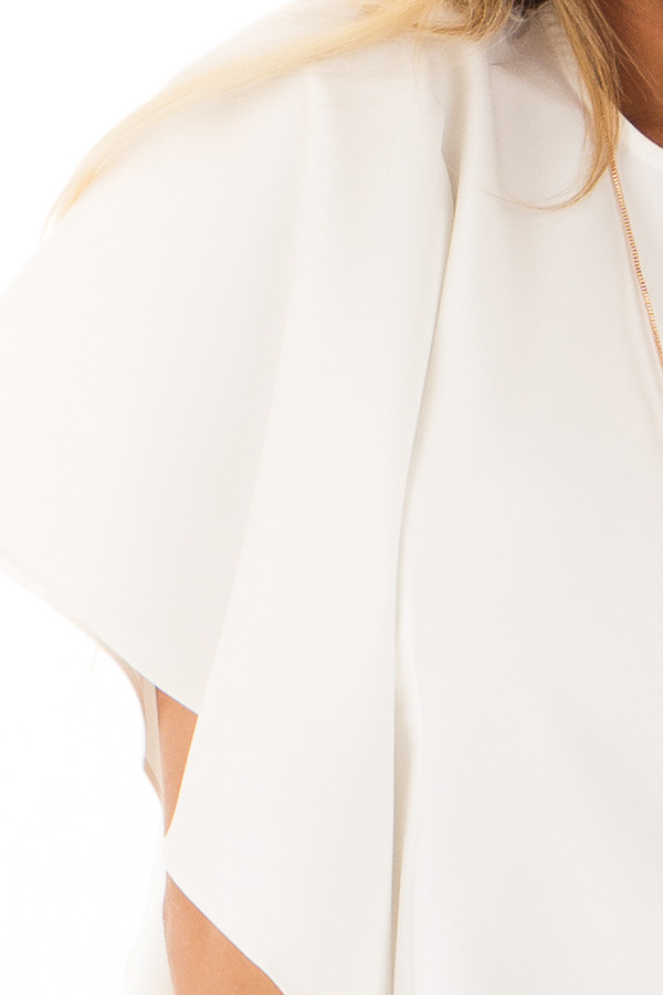 Ivory Ruffle Blouse with Back Zipper Closure detail