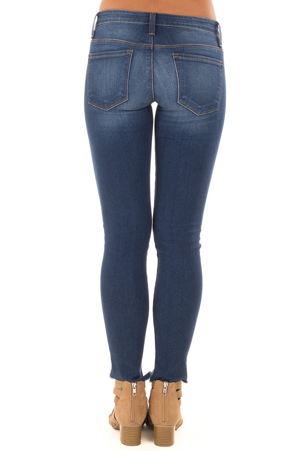 Dark Wash Skinny Jeans with Rounded Distressed Hem back view