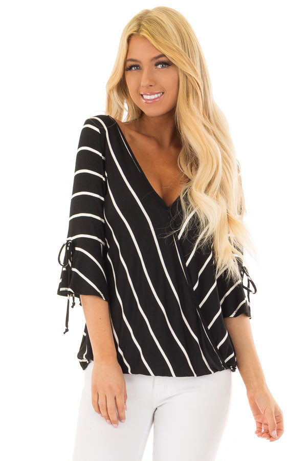 Black and White Stripe Surplice Top with Bell Sleeves front closeup