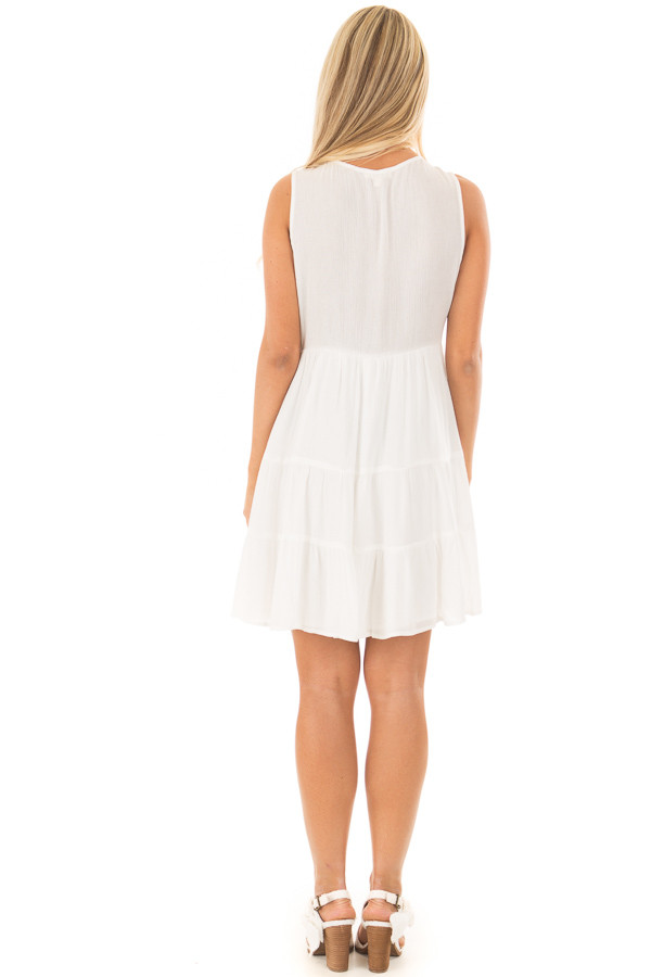 White Dress with Floral Embroidery and Tiered Skirt back full body