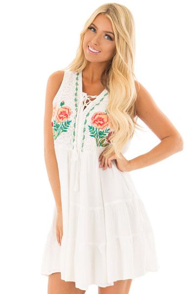 White Dress with Floral Embroidery and Tiered Skirt front close up