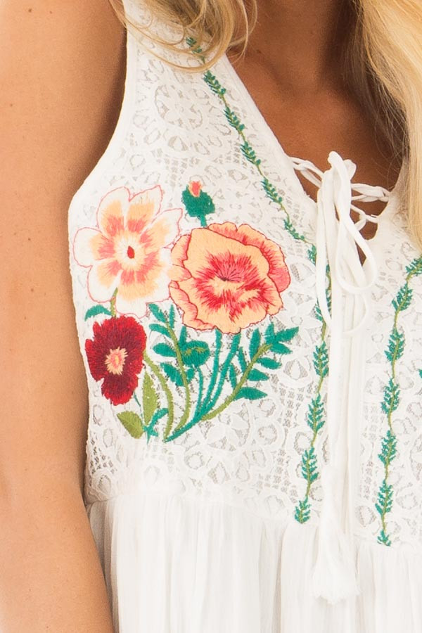 White Dress with Floral Embroidery and Tiered Skirt detail