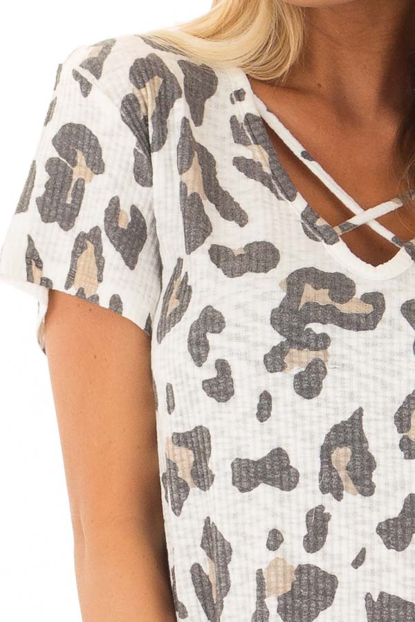 Ivory Leopard Print Ribbed Knit Top with X Neckline detail