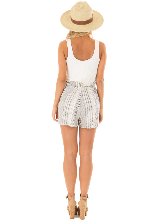 Cream Romper with Navy Patterned Detail and Front Tie back full body