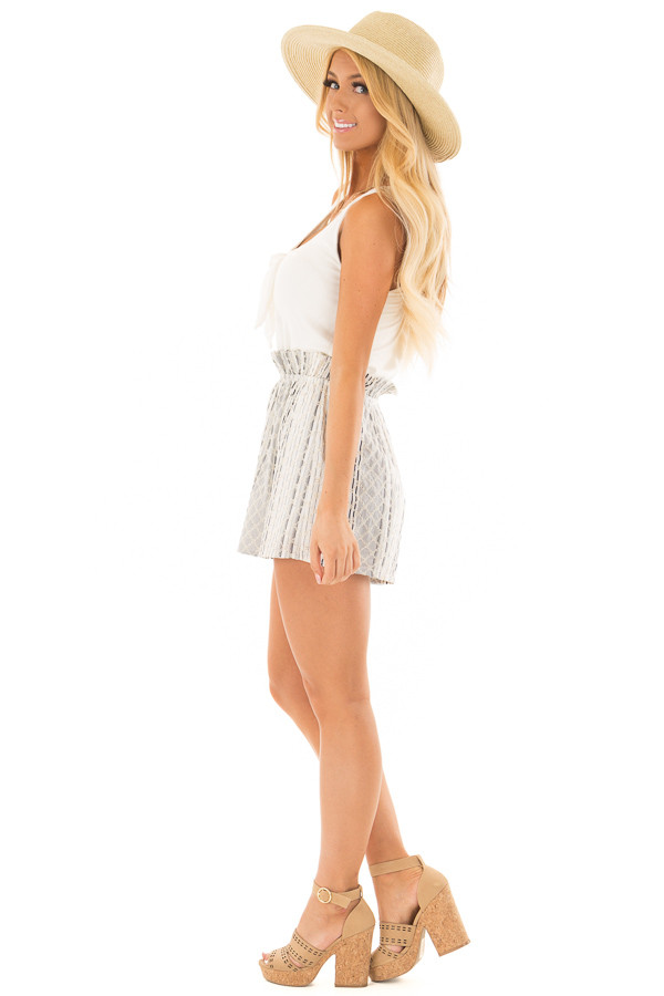 Cream Romper with Navy Patterned Detail and Front Tie side full body