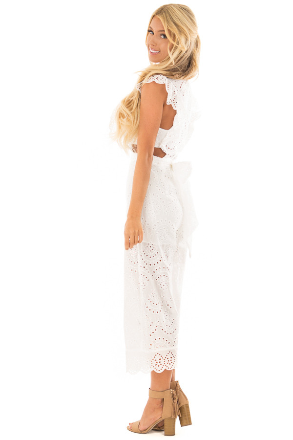 White Jumpsuit with Side Cut Outs and Flutter Sleeves side full body