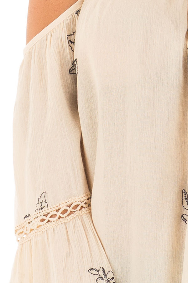 Cream Bell Sleeve Top with Floral Embroidery detail