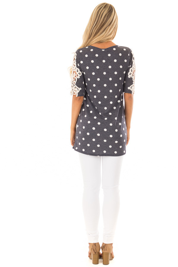 Navy Polka Dot Top with Sheer Lace Sleeve Detail back full body