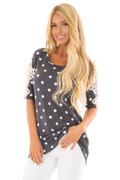 Navy Polka Dot Top with Sheer Lace Sleeve Detail front close up