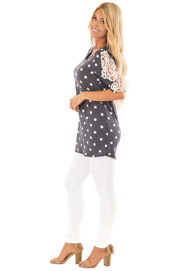 Navy Polka Dot Top with Sheer Lace Sleeve Detail side full body