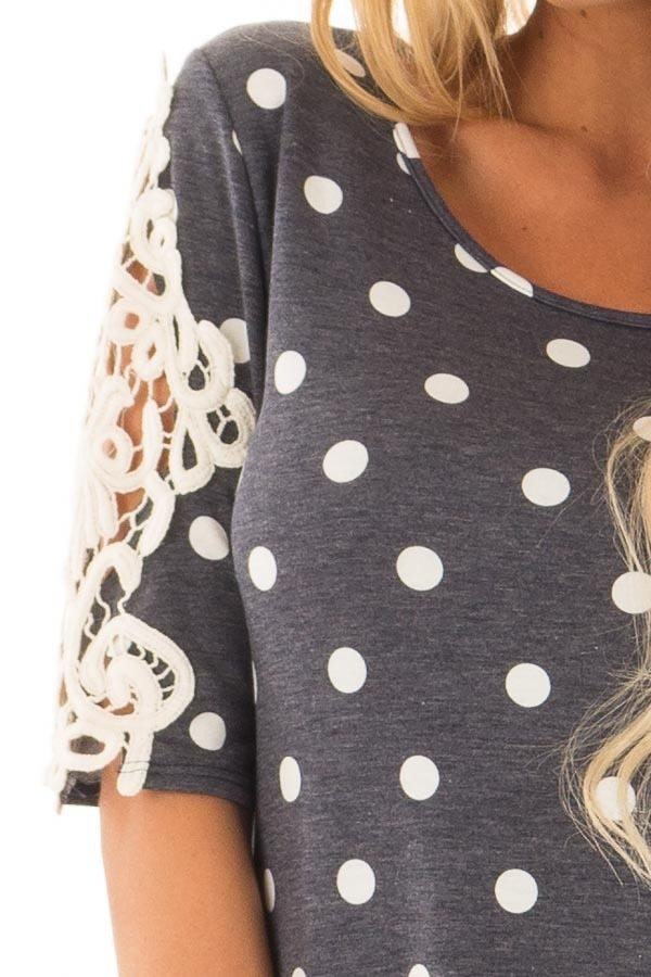 Navy Polka Dot Top with Sheer Lace Sleeve Detail detail