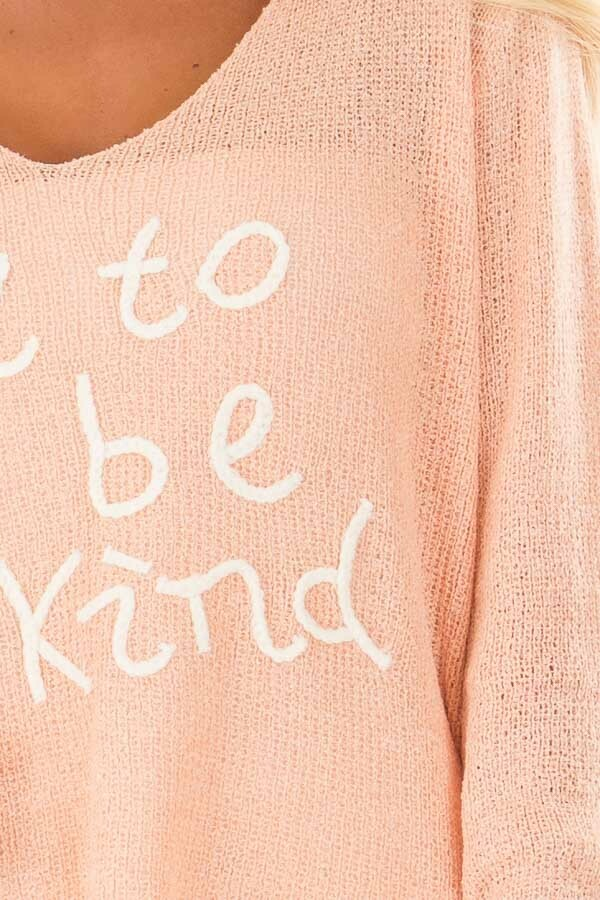 Peach 'It's Cool to Be Kind' Lightweight Sweater detail