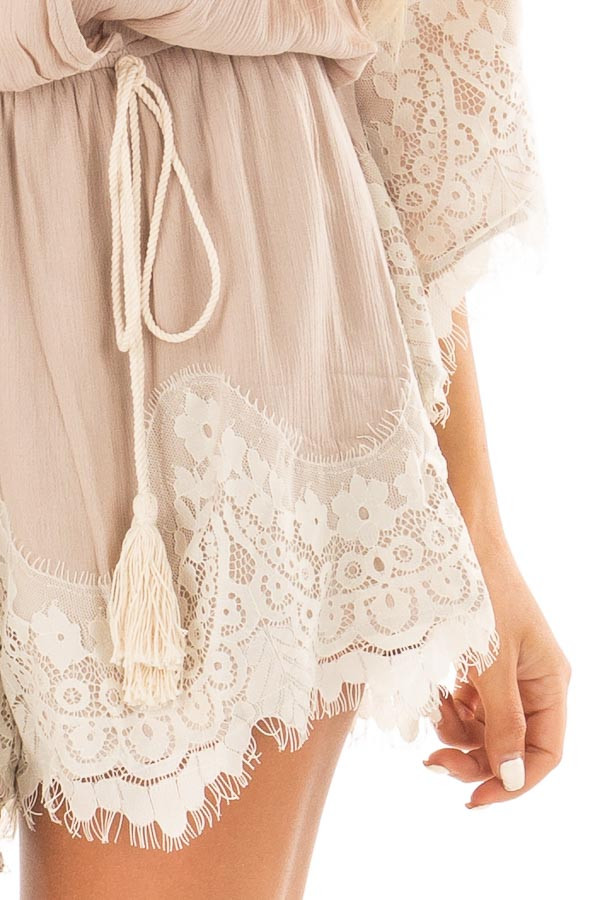 Latte Romper with Lace Trim and Tassel Tie detail
