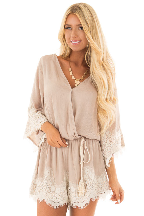 Latte Romper with Lace Trim and Tassel Tie front close up