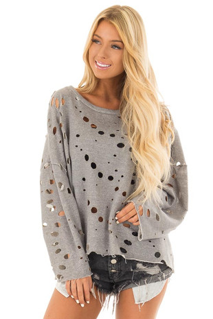 Grey Long Sleeve Top with Distressed Circular Cutouts front close up