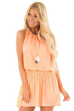 Neon Orange Dress with Smocked Waistline front close up