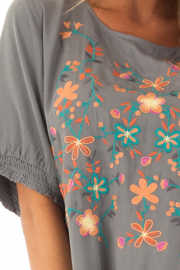 Faded Sage Embroidered Top with Ruffle Hemline detail