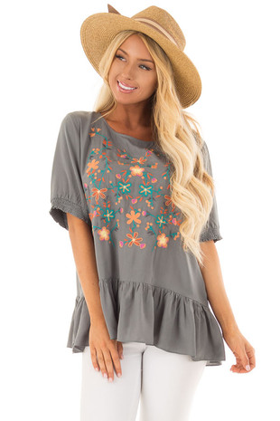Faded Sage Embroidered Top with Ruffle Hemline front close up