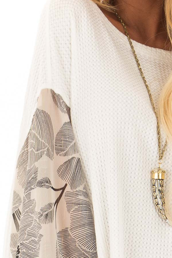 Ivory Waffle Knit Top with Flowy Black Floral Print Sleeves detail