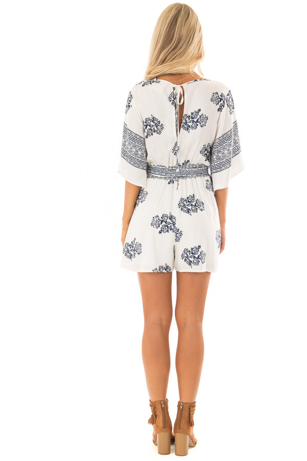 cWhite and Navy Floral Print Romper with Front Tie Detail back full body