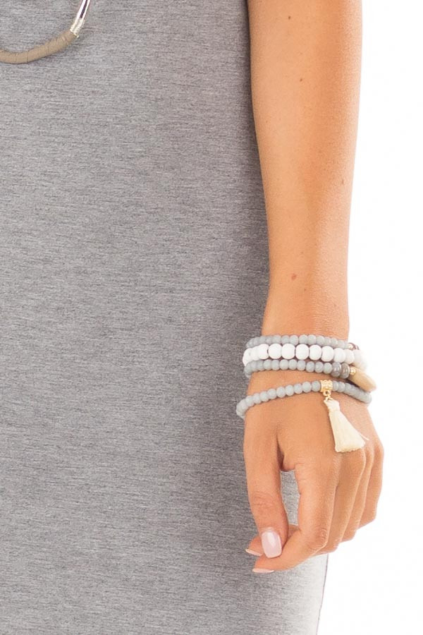 Grey Stackable Beaded Bracelets with Cream Tassel detail