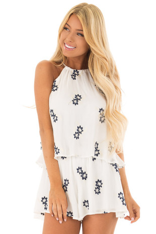 White High Neck Romper with Navy and Cream Floral Embroidery front close up