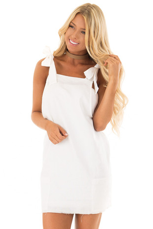 Ivory Overall Dress with Shoulder Ties and Pockets front closeup