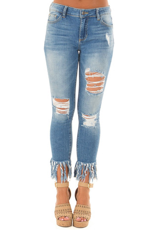 Medium Wash Distressed Denim with Shredded Hemline front view