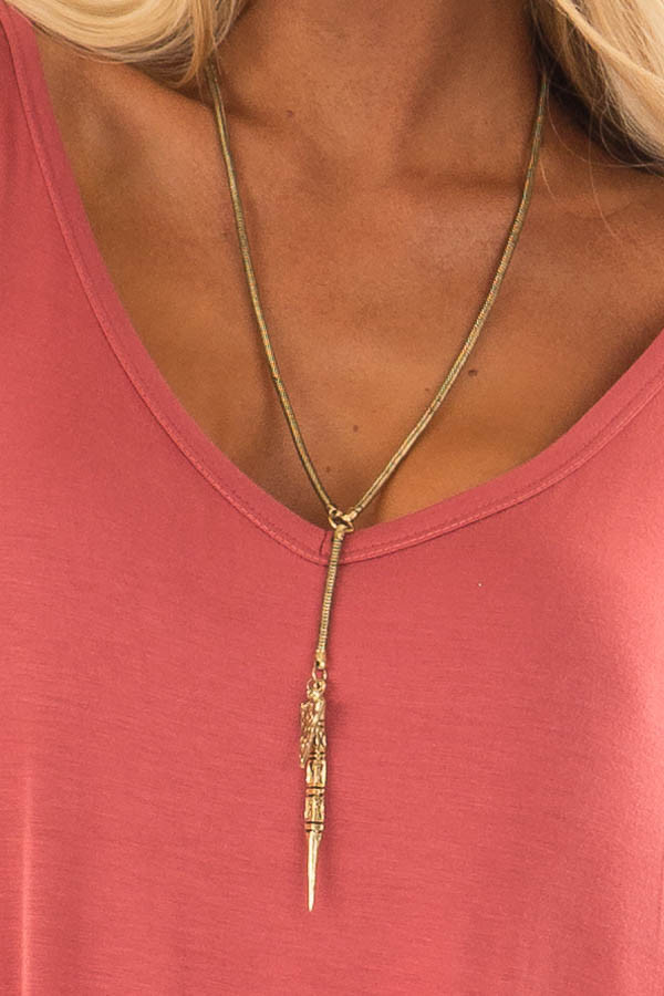 Antique Gold Round Chain Necklace with Dagger Pendant close up