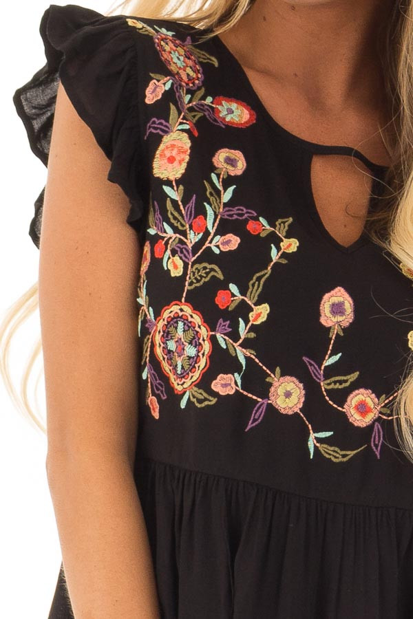 Black Embroidered Top with Neck Cut Out and Ruffle Sleeves detail