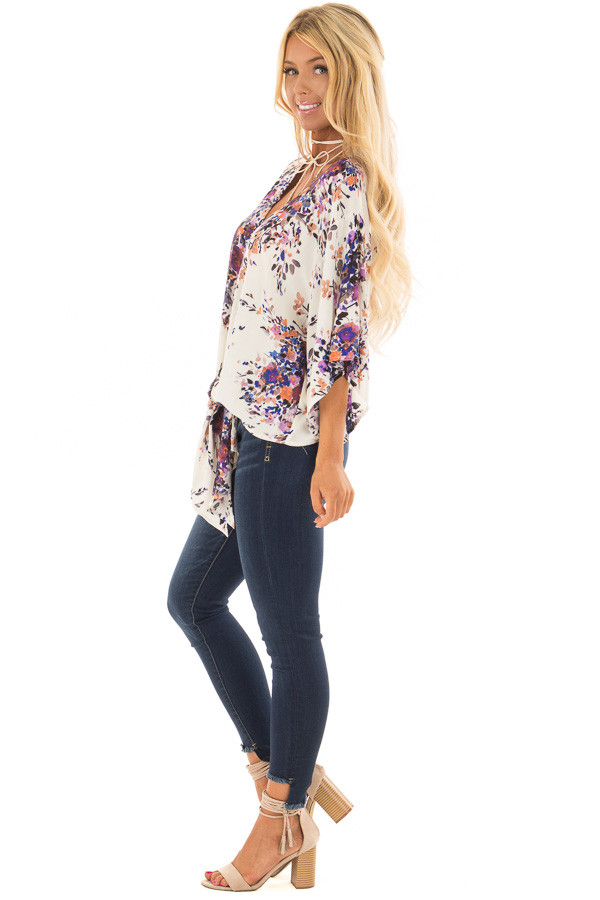 Cream Floral Print Short Sleeve Top with V Neckline side full body