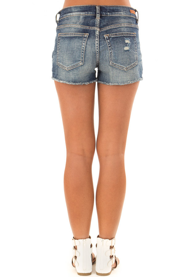 Dark Wash Distressed Shorts with Americana Exposed Pockets back view