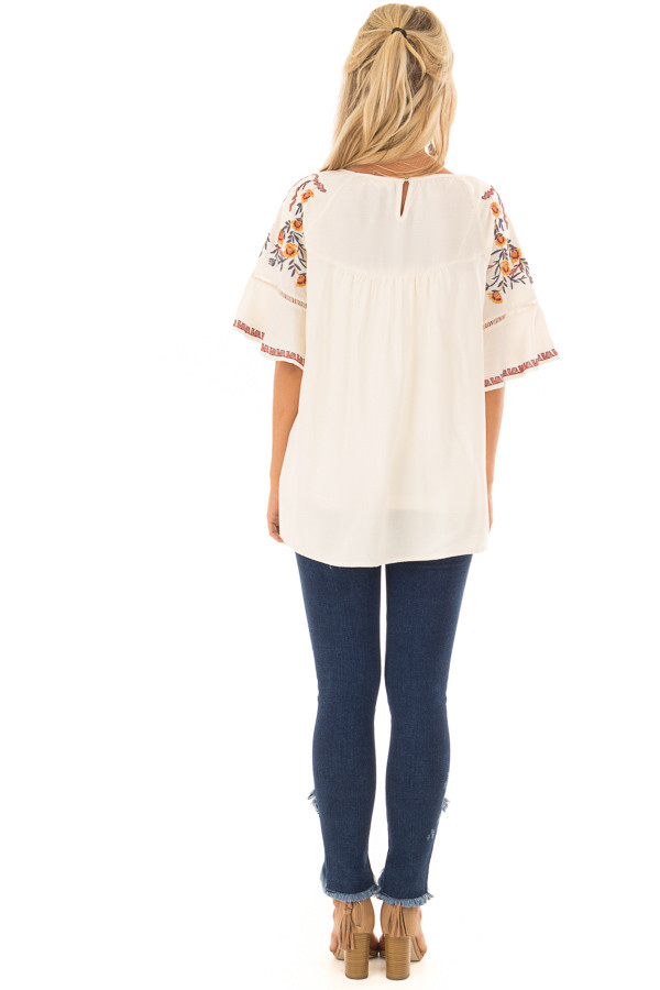 Cream Flowy Top with Wide Sleeves and Pleated Chest Detail back full body