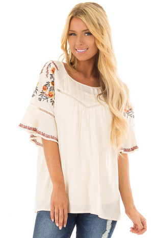 Cream Flowy Top with Wide Sleeves and Pleated Chest Detail front closeup