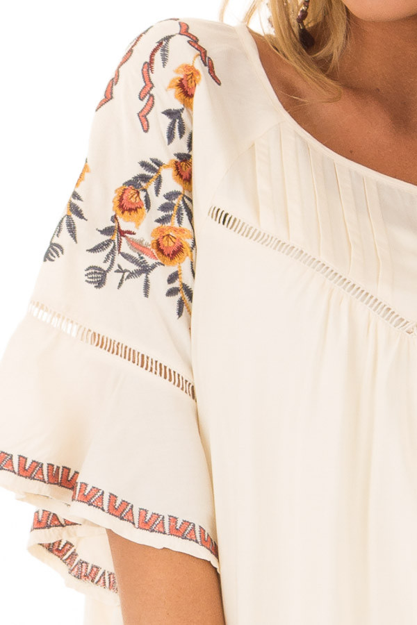Cream Flowy Top with Wide Sleeves and Pleated Chest Detail front detail