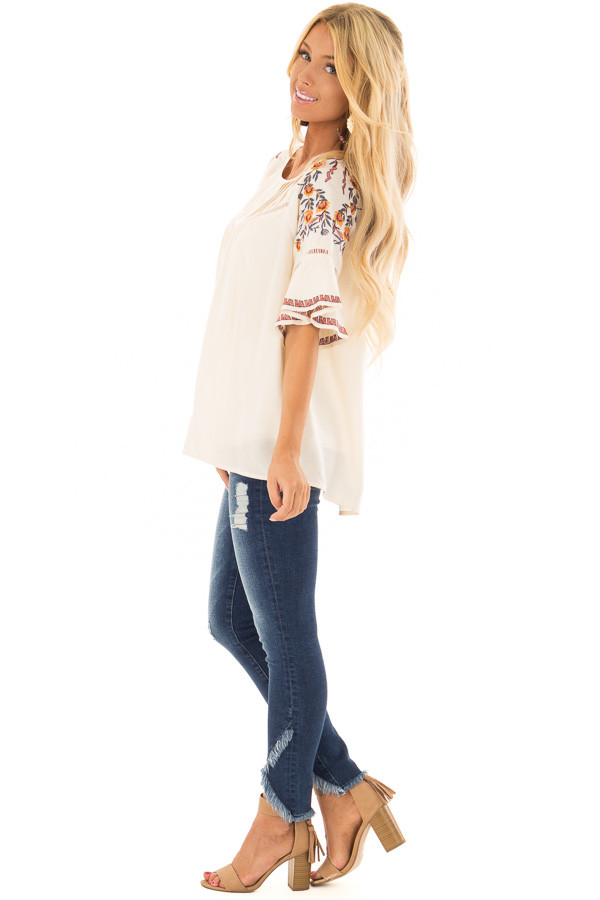 Cream Flowy Top with Wide Sleeves and Pleated Chest Detail side full body