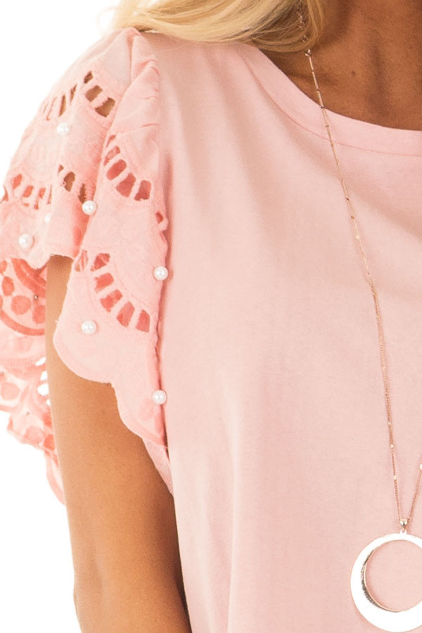 Blush Top with Crochet Short Sleeves and Pearl Detail front detail