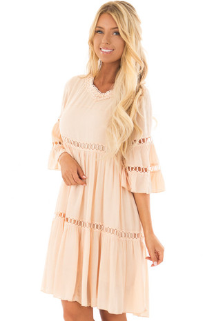 Blush Bell Sleeve Ruffle Babydoll Dress with Keyhole Back front closeup